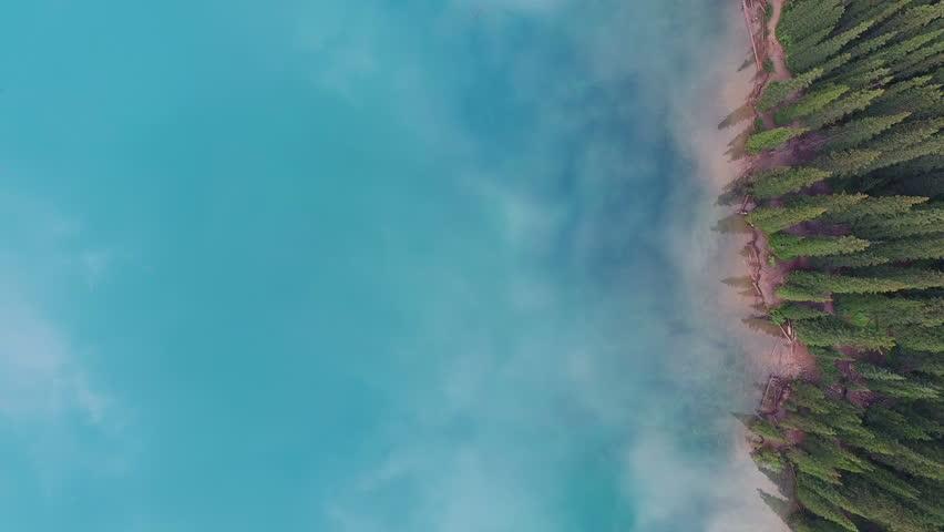 4K Aerial drone shot of Lake Moraine in Banff National Park, Alberta, Canada at sunrise