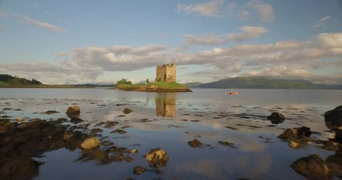 Aerial shot of Castle Stalker on the west coast of Scotland between Fort William and Oban in the morning with a sunset