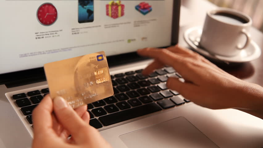 Online shopping. 3 shots. Dolly. Female hand holding a gold credit card and shopping online. More options in my portfolio. #11744465