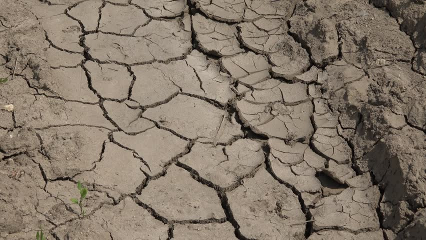 Cracked dry land in a desert stock footage video 3586412 4k desert ground view pollution and warming climate arid surface and global disaster by sciox Images