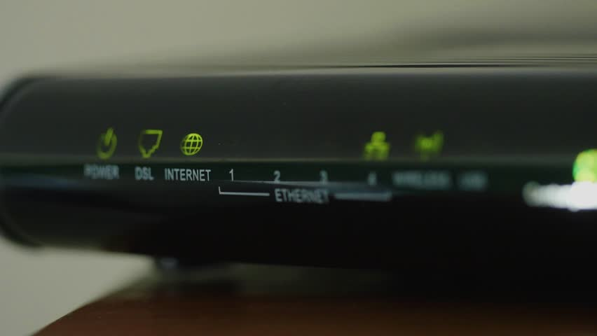 Lights blink on a internet router box in an office | Shutterstock HD Video #11776355