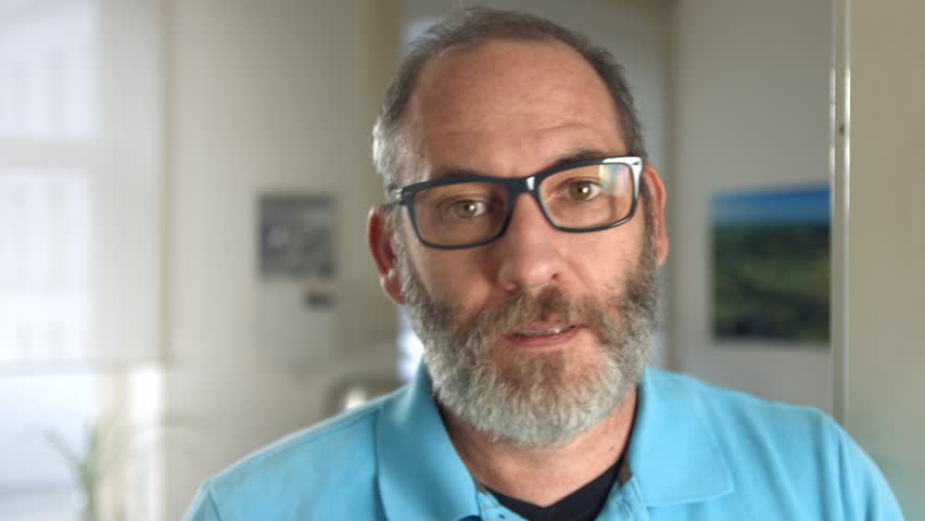 Portrait of a fashionable mature professional creative man with glasses in his office looking into the camera, close up shot | Shutterstock HD Video #11809892