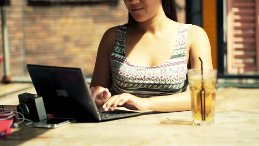 Young female student finish working on laptop and taking coffee break in cafe   | Shutterstock HD Video #11814455
