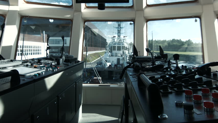 Sailor controls boat in the wheelhouse   Shutterstock HD Video #11816345