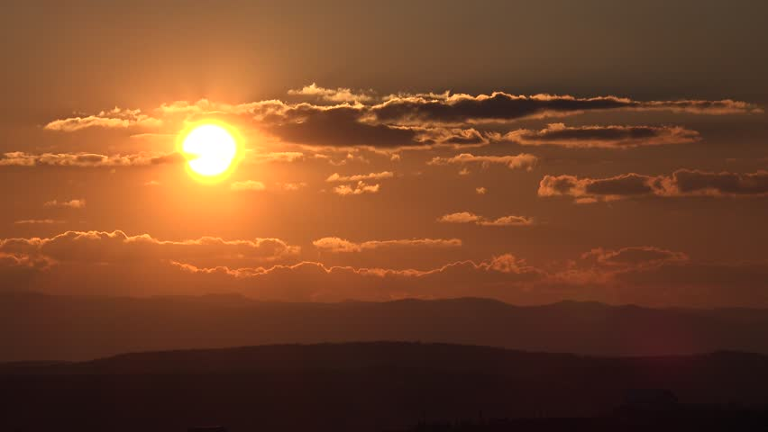 4K Amazing sunset or sunrise, sun silhouette go down, mountain hill and orange light, romantic scene by day #11830145