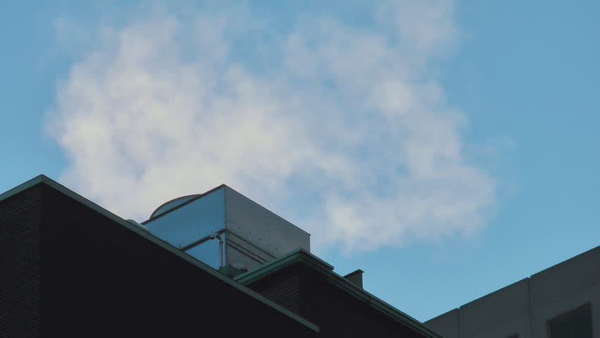 Steam From Heating Equipment On A Cold Spring Day Coming From An Office Tower Building | Shutterstock HD Video #1184035