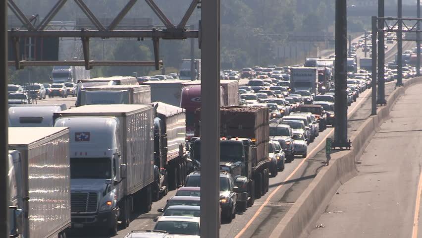 Pickering, Ontario, Canada September 2015  Smog and rush hour traffic jam along the 401 in Ontario GTA | Shutterstock HD Video #11870795