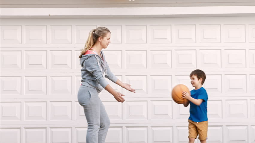 mom and son playing basketball