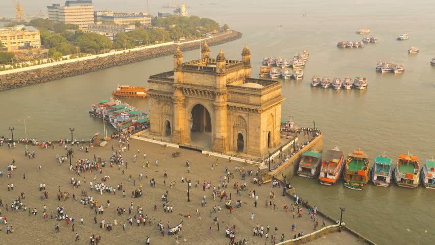 India - March 2015: Mumbai time lapse India Gate Maharashtra Asia monument Bombay illuminated dusk boat people tourist