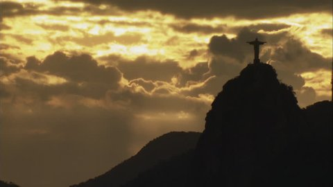 Silhouette of Christ the Redeemer on top of Corcovado mountain against sky at sunset / Rio de Janeiro, Brazil, 04/01/2007