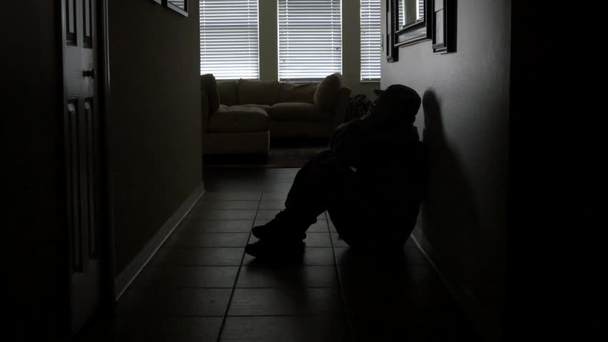 A soldier's sits in a dark hallway while dealing with PTSD, WIDE, 4K | Shutterstock HD Video #11945795