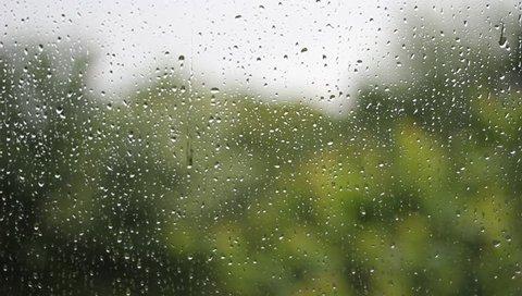 Raindrops running down a window.