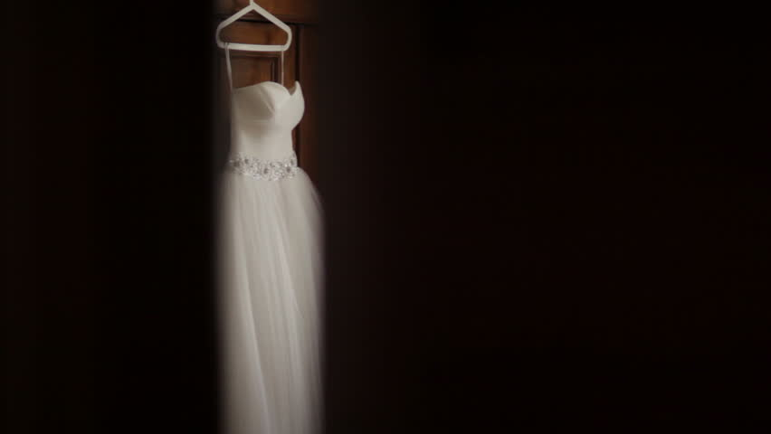 MS TD White Wedding Dress Hanging In Bedroom Stock Footage Video 11965475