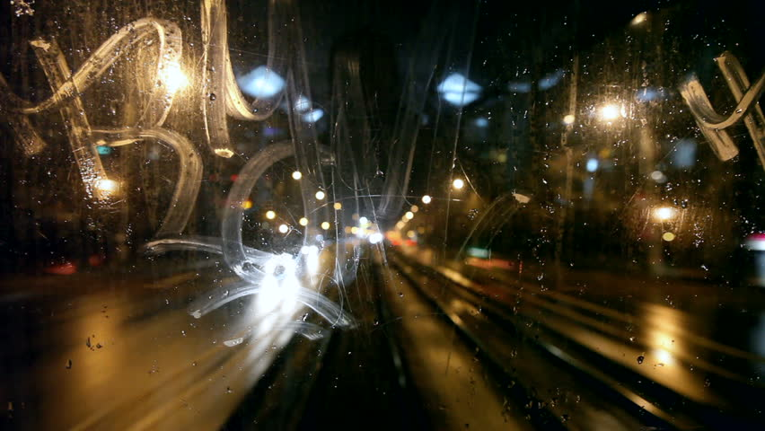 Tram's rear window view. Tram passes through tunnel. Cold rainy weather cityscape. Steamy window. Night time. Focus on window.  | Shutterstock HD Video #1196785