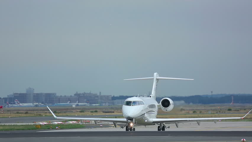 FRANKFURT AM MAIN, GERMANY - SEPTEMBER 5, 2015: Private Jet Bombardier Challenger 300 OE-HUG on executive at runway18. Unofficial spotting in Fraport on Sep. 5, 2015