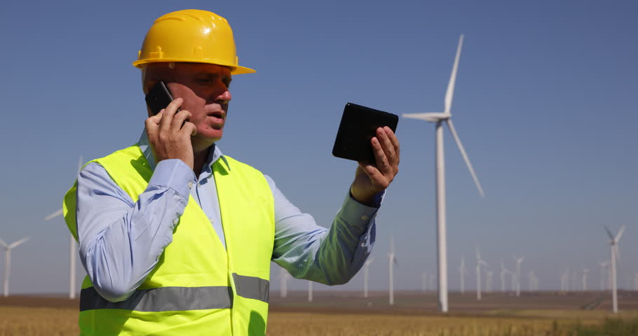 Blueprint draw plans maintenance technician working energy wind turbines engineer use mobile phone touch tablet contact maintenance team ultra high definition malvernweather Images