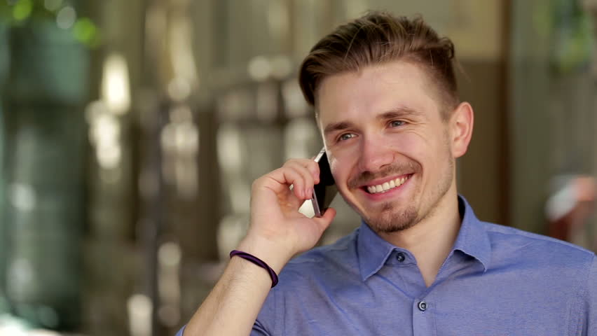 Young businessman is talking on his mobile phone  outdoors   Shutterstock HD Video #12039725