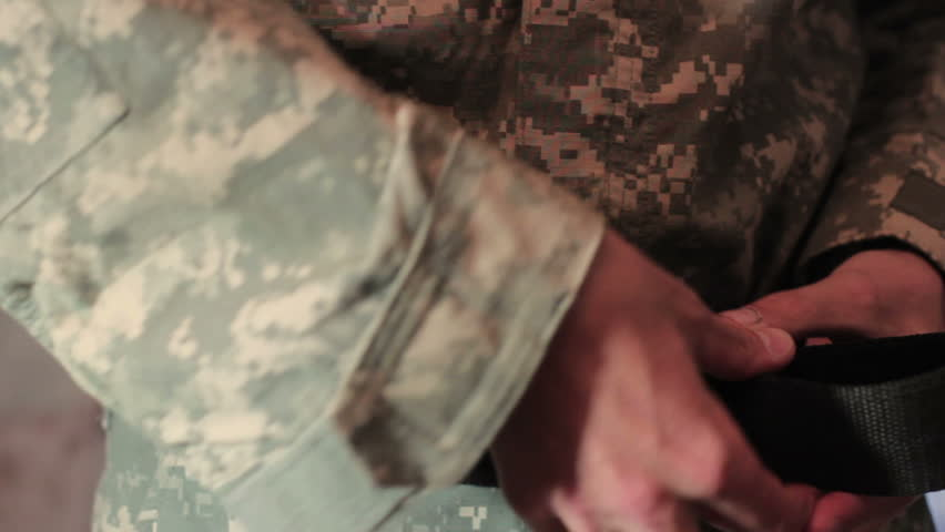 Soldier wears a military uniform close-up. | Shutterstock HD Video #12040175