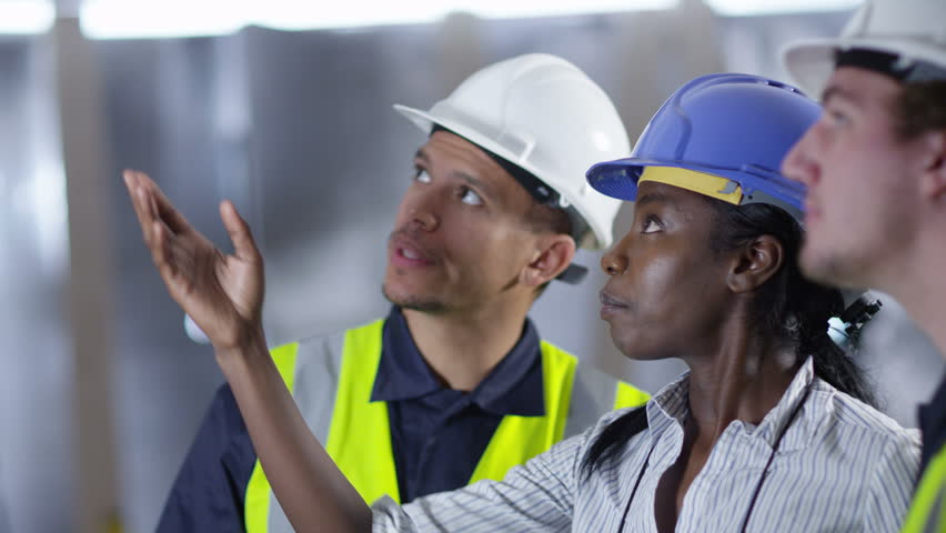 4k Confident female engineer or architect discussing construction issues with male colleagues. Shot on RED Epic.