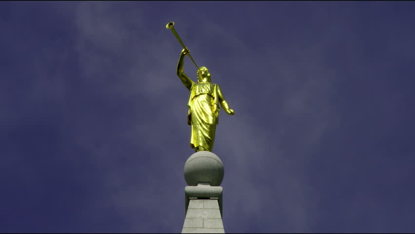 Golden Angel Moroni statue atop Mormon temple in Salt Lake City, Utah.