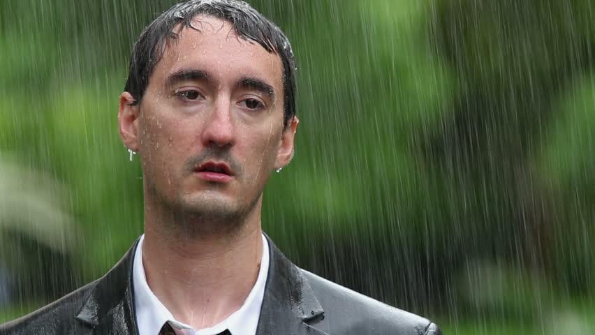 Man wearing suit standing in rain | Shutterstock HD Video #1213372