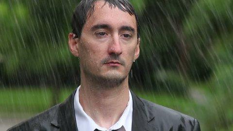 Business man celebrating in rain
