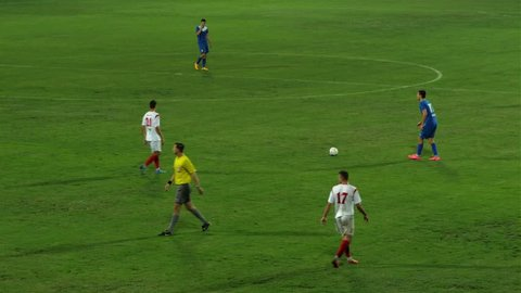 """Krusevac,Serbia - 08.15.2015: Championship game """"First League Serbia"""" FC Napredak-FC Donji Srem,Krusevac,Serbia,19.09.2015.Player performing free kick,center shot in the sixteen meter,goalkeeper catch the ball,very good chance."""