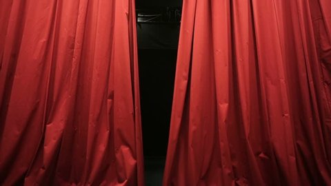 Opening red curtain in a theater