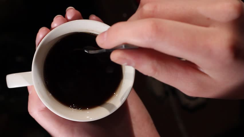 Hand striring sugar in a coffee cup #12152495