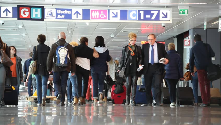 ROME - OCTOBER 09 2015: unidentified passengers walking in international airport of Fiumicino, commuters in transit terminal, Italy