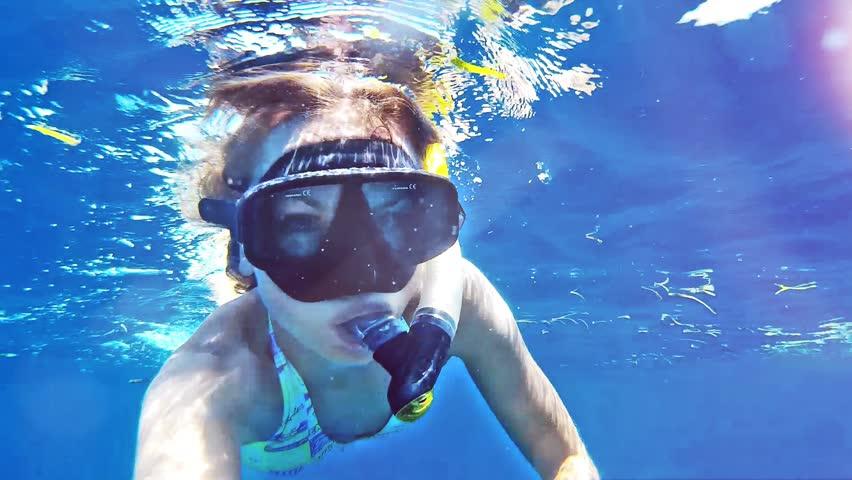Beauty girl  snorkeling in Indian ocean on Bali. Indonesia.