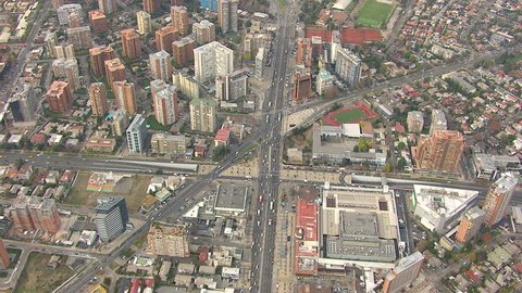 WS AERIAL View of buildings and highway / Santiago, Central Valley, Chile