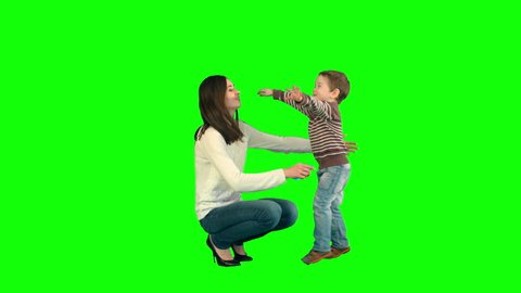 Lovely portrait of a mother and son on a Green Screen, Chroma Key. Professional shot on BMCC RAW with high dynamic range. You can use it e.g in your commercial video, family video, music video.