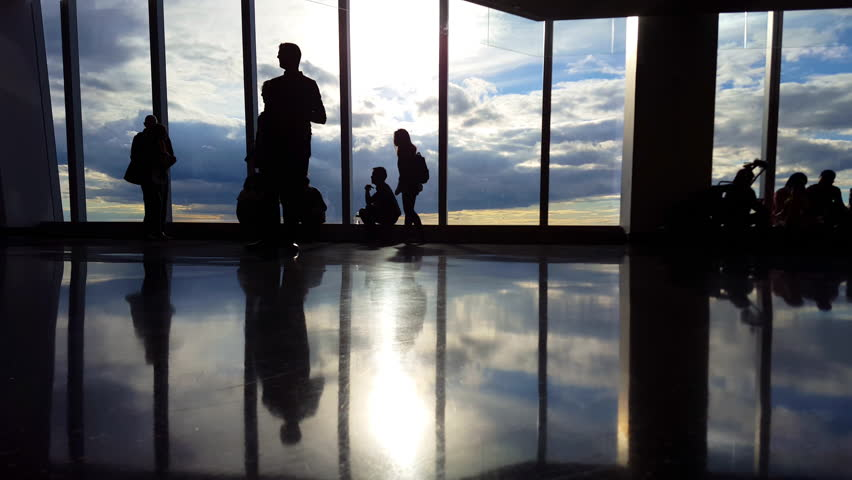 People at Airport Terminal Silhouette of travelers Waiting to board flight 4K | Shutterstock HD Video #12254930