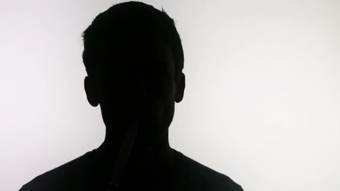 silluet of a man smoking a hookah