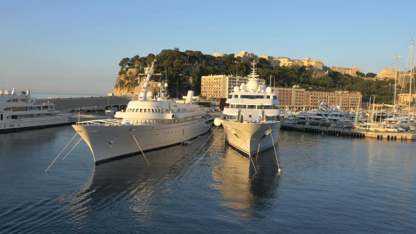 Monaco - June 2015: Aerial UAV Monte Carlo sunset investment wealth coastline vacation tourism sea harbor boat seascape travel