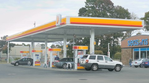 PROVIDENCE, RI - OCT 19, 2015: Commuters refuel their cars at Shell gas station on October 19, 2015. Shell is the market leader of petrol stations with over 25,000 Shell-branded gas stations in the U.S.