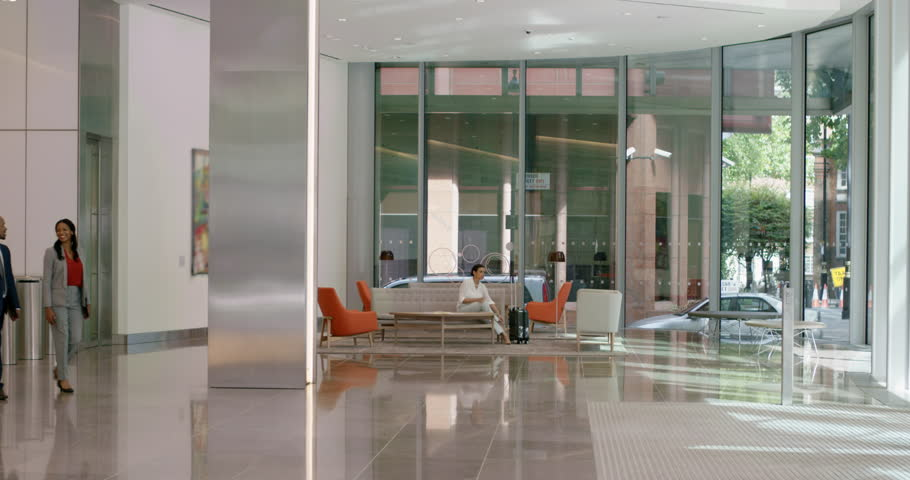 Portrait Of Business Woman At Work In Busy Corporate Office Lobby Smiling With Confidence Leadership Strategy Concept Stock Footage Video 12323765