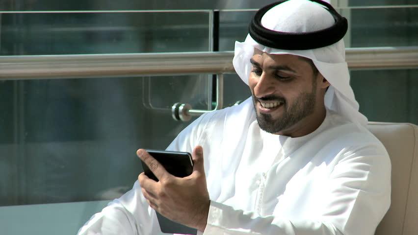 Handshake Arab business male kandura tablet technology property construction