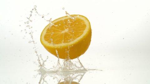 Lemon falling and bouncing. Shot with high speed camera, phantom flex 4K. Slow Motion.