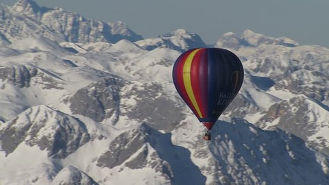 WS AERIAL Scenic view of mountainous landscape with hot-air balloons / Grimming, Styria, Austria - 01/21/2015