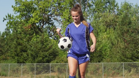 Female soccer player juggling a ball