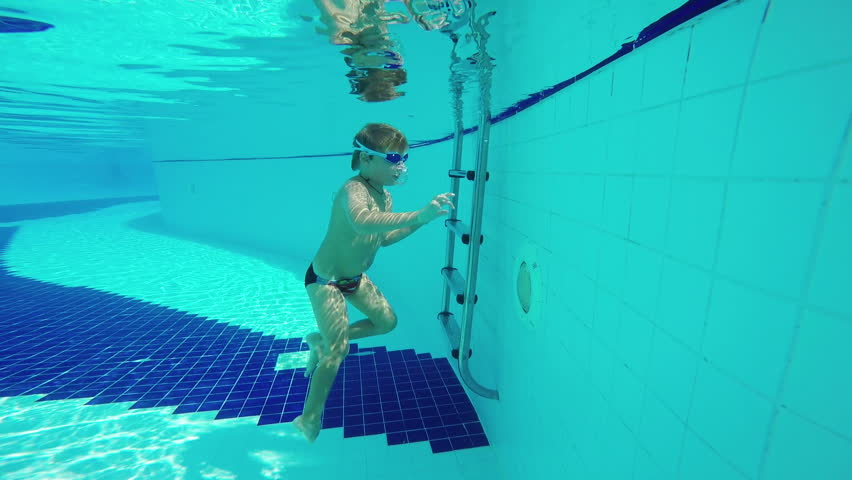 Stock Video Clip Of Little Boy Swimming Underwater In The Pool Shutterstock