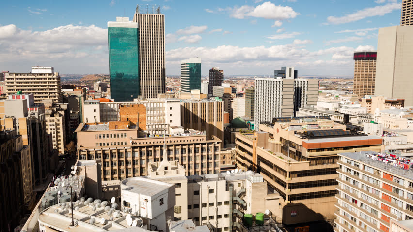 A slow panning timelapse across the city centre of Johannesburg (CBD) in the daytime with bright blue skies and cumulous clouds showing the High Court(Johannesburg, Gauteng, South Africa - 25/07/2015) #12369485