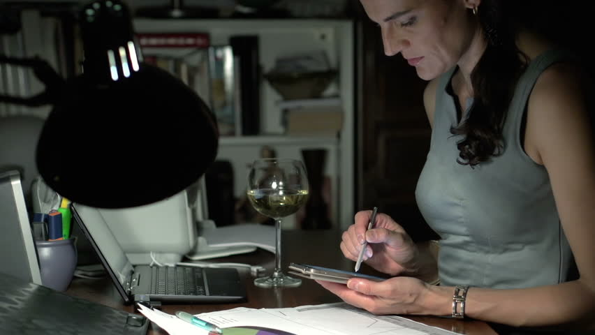 Woman using smartphone at night at the desk, steadycam shot  | Shutterstock HD Video #12378695