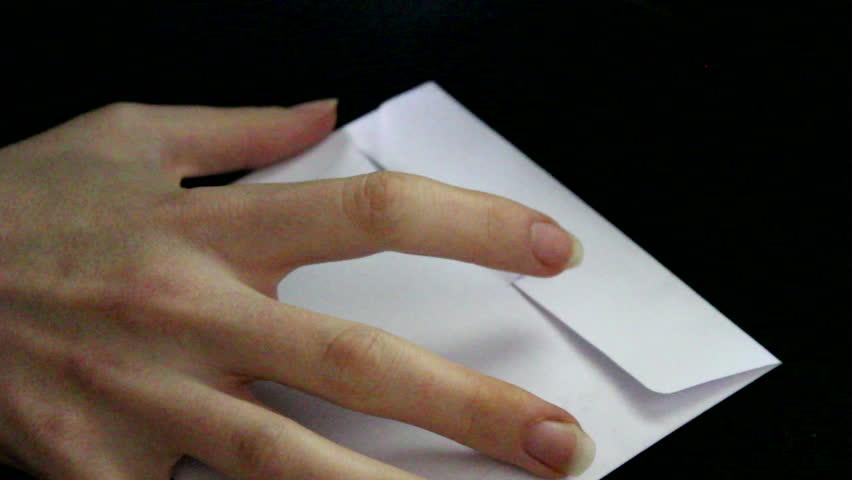 Taking of CD from white envelope