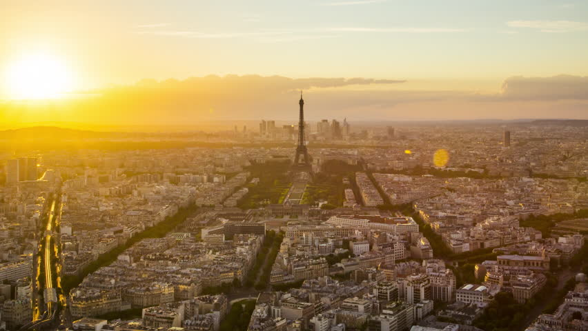 Day to night time lapse of sun setting over Paris skyline, seen from Tour Montparnasse 56, Paris, France | Shutterstock HD Video #12385145