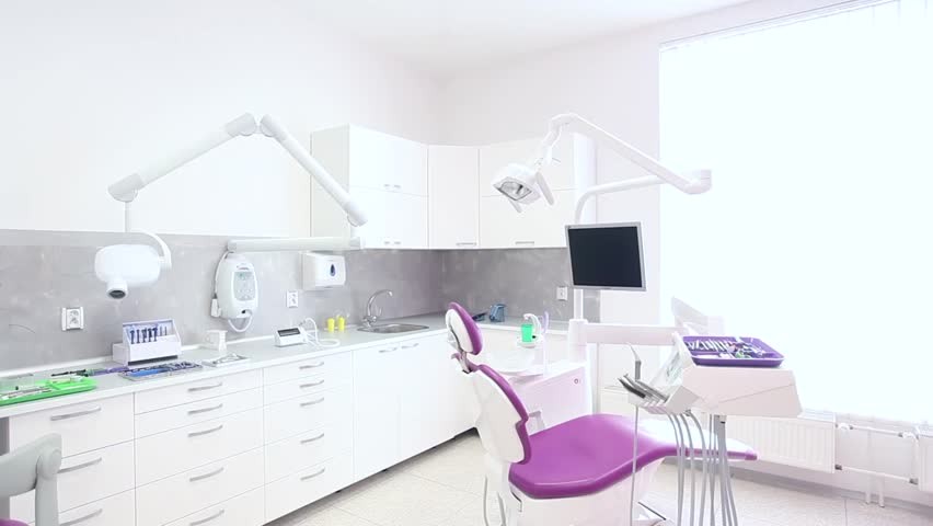 A Dental Clinic Interior Design Purple Chair With Tools And Lamp Over White Walls