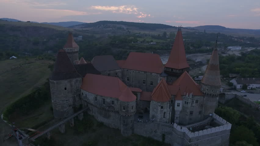 4K aerial shot of the Corvin Castle at sunset – a Gothic-Renaissance castle in Romania and one of the largest castles in Europe | Shutterstock HD Video #12409805