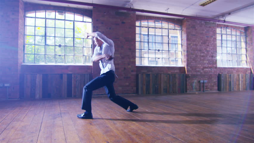 4K Young Asian martial artist training alone, practising his moves with a shaolin whip chain. Shot on RED Epic.
